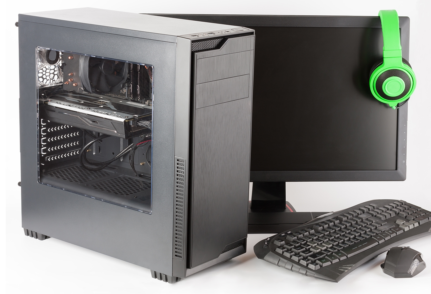 Gaming computer with monitor and headphones.